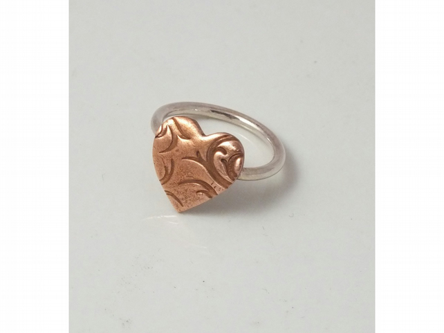 Copper and silver heart shaped ring