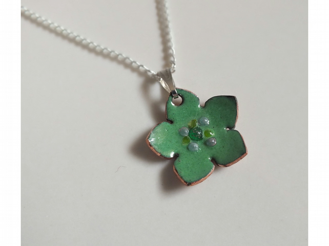 Green enamel flower pendant