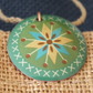Green folk art style enamelled pendant
