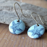 Starfish enamel earrings, blue background