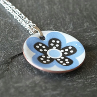 Black and blue flower pendant