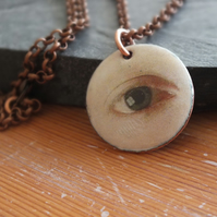 Eye enamelled pendant
