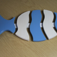 Fish shaped wooden trivet, blue & white in colour