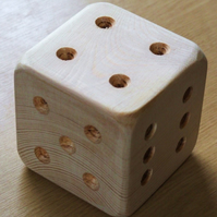 Large wooden dice or die. Ideal for young child.