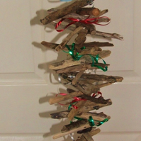 Driftwood wallhanging decoration with tinsel or ribbon for Christmas festivities