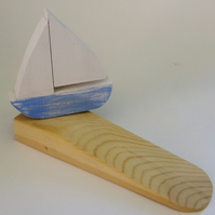 Door wedge with a sailing yatch or boat decoration, for that nautical theme.
