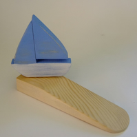 Door wedge with a yatch or boat. Ideal for sailing enthusiasts or mariners.