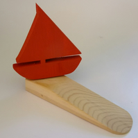 Door wedge with a yatch or boat. Ideal for seaside cottage or beach hut.