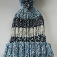 Shades of blue knitted bobble hat hand made from warm soft chunky wool.