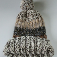 Shades of brown knitted bobble hat hand made from warm soft chunky wool.