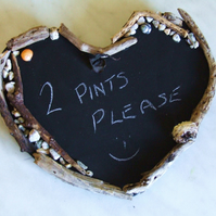 HEART SHAPED CHALKBOARD WITH DRIFTWOOD SURROUND FOR DISPLAY IN BEACH HUT