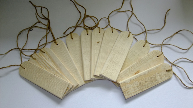 12 wooden gift tags for tying onto birthday or Christmas presents.