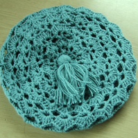 Sage green ladies crotchet beret style hat in acrylic doudle knitting wool.