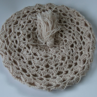 Beige ladies crotchet beret style hat in acrylic doudle knitting wool.