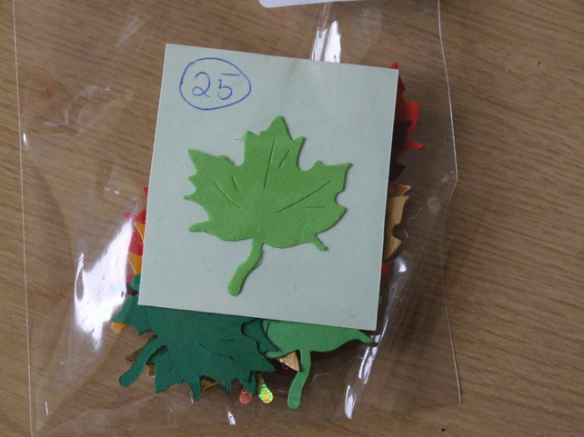25 maple leaf shaped Sizzix die cuts for card embellishments & crafting.