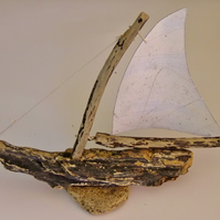 DRIFTWOOD YATCH OR SAILING BOAT WITH ALUMINIUM SAILS.
