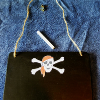 Chalkboard or blackboard with pirate skull & crossbones image for messages notes