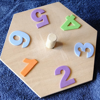 Child's six sided spinning top with foam crafting numbers, fun for counting.