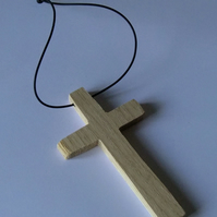 Little hanging wooden crucifix or cross ideal to hang on car interior mirror