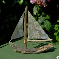 Little driftwood boat with Ordnance Survey map for sail Falmouth & Porthscatho