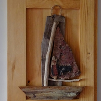 Driftwood sailing boat or dinghy mounted in a reclaimed wooden door panel