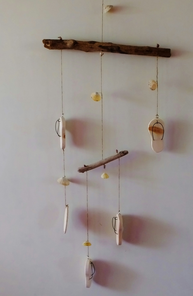 Driftwood mobile with wooden flip flops, surf board and sea shells decoration