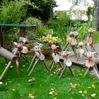 Wooden reindeer decoration to go in garden or patio at Christmas Xmas time.
