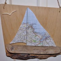 Driftwood yatch or sailing boat with Ordnance Survey sails of St. Ives & Hayle