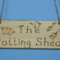 "HANGING SIGN FOR THE GARDENER SAYING ""IN THE POTTING SHED"""