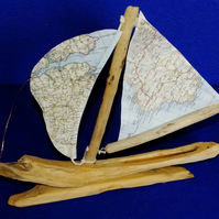 Little driftwood boat with Ordnance Survey map for sail Land's End & St. Austell
