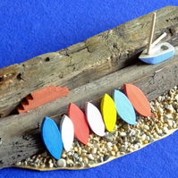 Harbourside quayside wall scene surfboards dinghy pebble beach Cornish driftwood