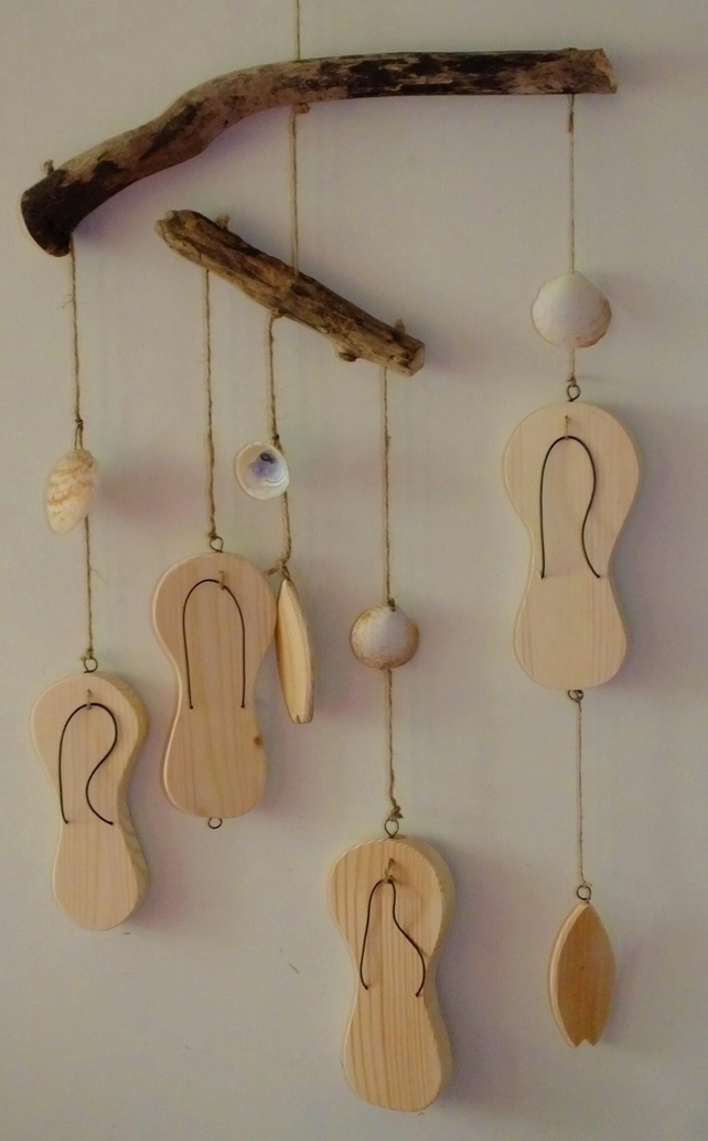 Driftwood mobile with flip flops, sea shells and surf boards ideal for summer.