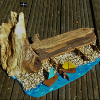 Harbour wall breakwater & cave rugged cliff pebble beach with groynes surfboard