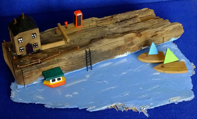Driftwood seaside clifftop scene sailing boats with shipwreck fishing boat