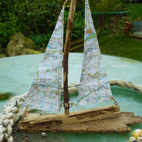 Cornish driftwood sailing ship yacht with ordnance survey map sail decoration