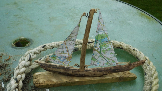 Driftwood sailing ship yacht with ordnance survey map sails Norfolk area