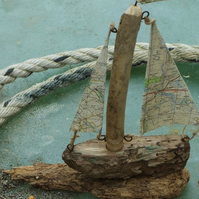 Little driftwood sailing ship yacht with ordnance survey map sails