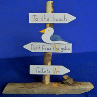 SIGN TO THE BEACH, CAR PARK, CAFE, DON'T FEED THE GULLS, TOILETS