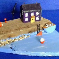 Driftwood seaside harbour quayside scene with fishing boat blue sea & buoys