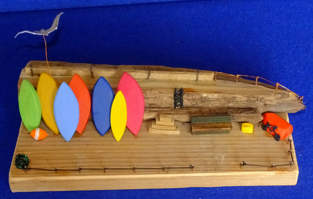 Driftwood seaside harbour quayside scene with surf boards & grit bin ladder