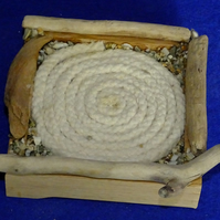 Coaster place mat for cup or mug with coil of rope & pebbles nauticle maritime