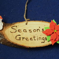 Season's greetings natural wooden sign for Christmas time