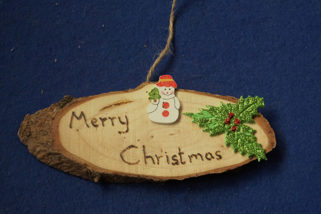 Merry Christmas natural wooden decoration or sign for Christmas time