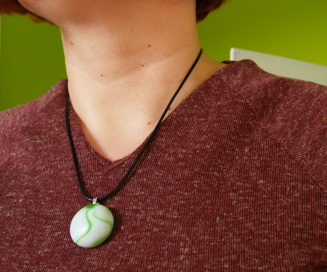 Gorgeous pearl white glass necklace with lime green swirling