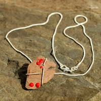 Enamelled Lakeland Slate set in silver.