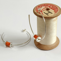 Cotton reel hoop earrings