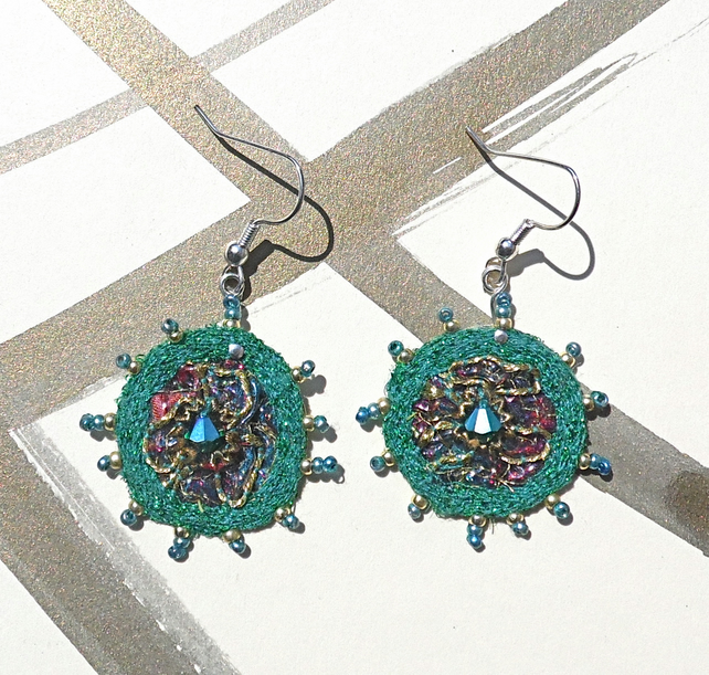 Embroidered earrings.