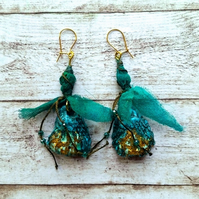 Polymer clay green shell silk bead dangly earrings.