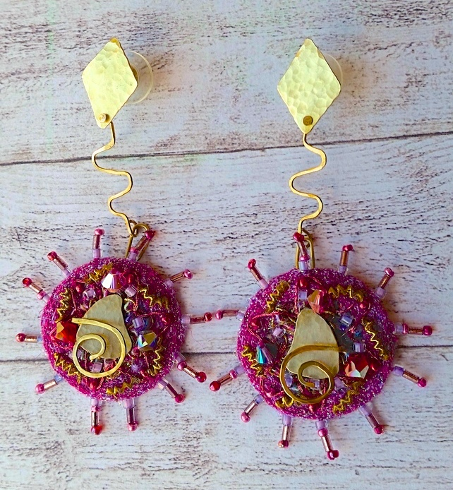 Textile embroidery and beaded earrings.
