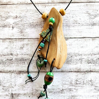 Driftwood and bead pendant necklace.